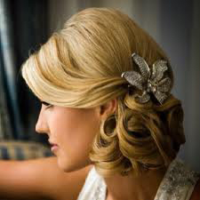 low-loose-curls-bun-flower-hairpiece-hairstyle
